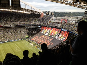 The stadium and a hard-core crowd-held banner