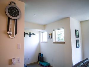 A view of the workout room behind the couch off of the living room